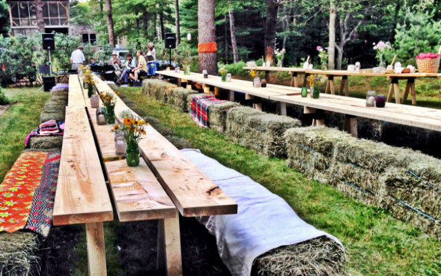 hay bales for chairs and wooden board tables at pot luck gathering summer of 2014 in Falmouth MA